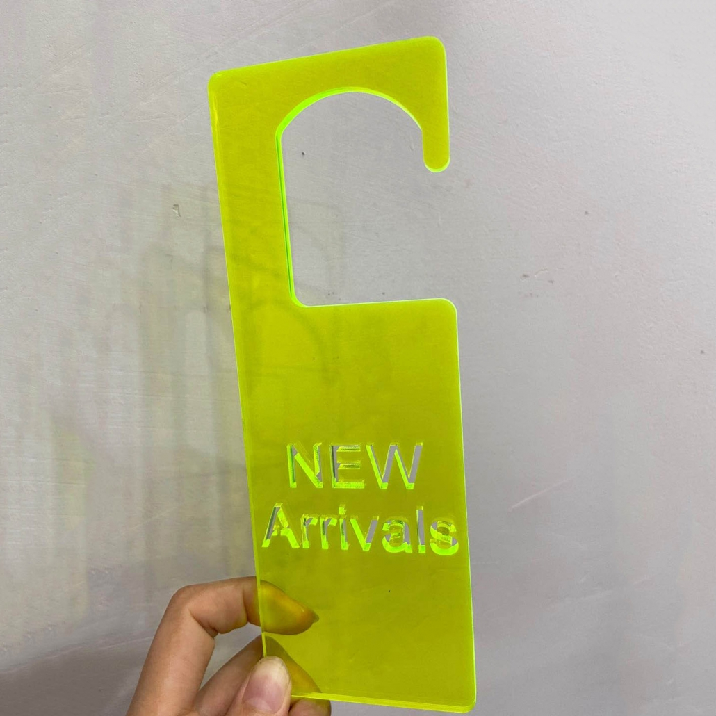 Acrylic new arrival sign bright yellow color