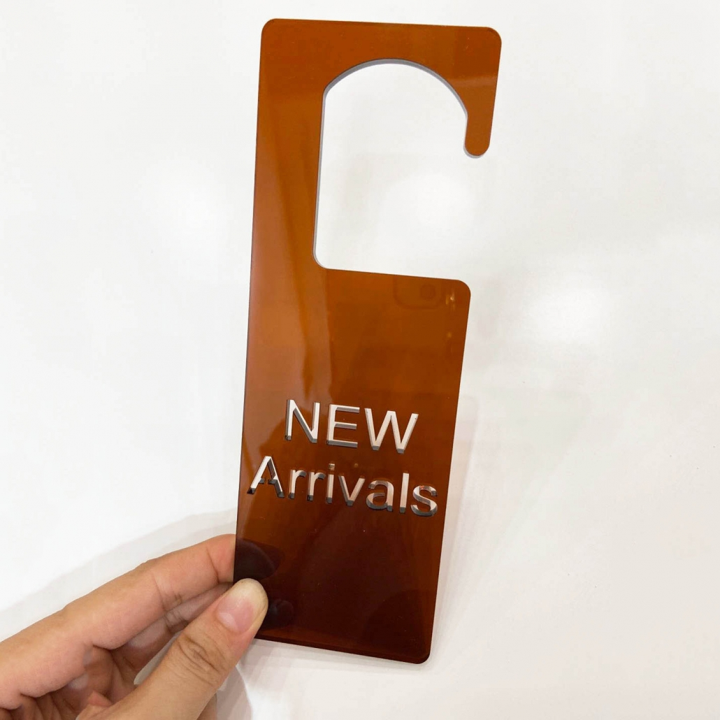 Acrylic new arrival sign brown color