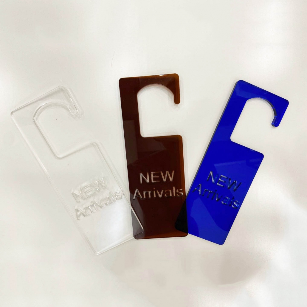 Acrylic new arrival sign for fashion store