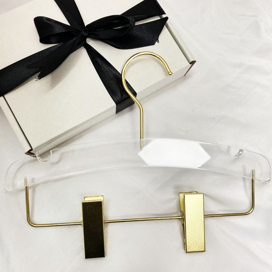 acrylic hanger with gold hook and clips for kids clothes